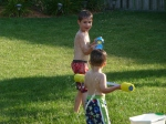 Noah tests his aim on Levi. All systems go for some water fun.